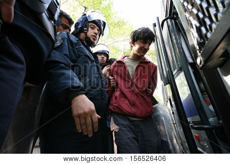 ISTANBUL, TURKEY - MAY 1: An unidentified demonstrator who is against to prohibition of May 1 celebration is taken into custody by the police on May 1, 2007 in Istanbul, Turkey