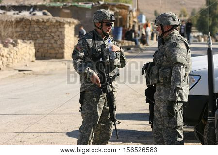 MAXMUR CITY, IRAQ - JANUARY 26: Unidentified USA soldiers stands guard in a check point on January 26, 2007 in Maxmur, Iraq.