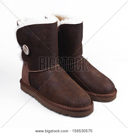 stylish winter brown shoes over white background