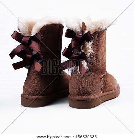 Fluffy woolly warm boots isolated over white