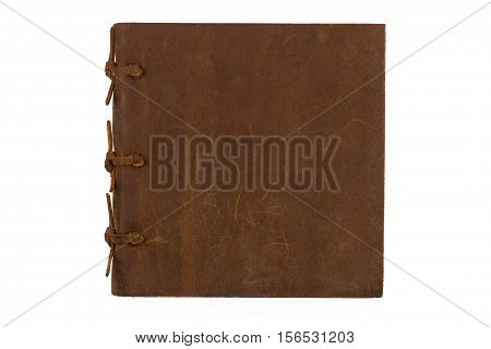 top view of closed notebook with leather brown and bindings cover isolated on white background
