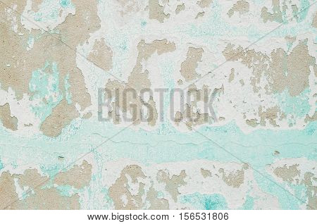 Closeup pale color and peeling of painted green cement wall textured background