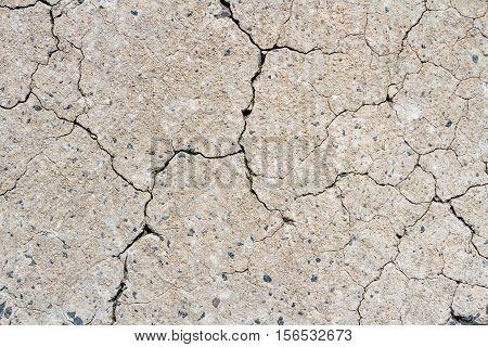 Closeup Of Cracked Concrete Floor Texture With Flint