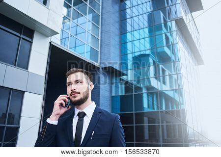 The guy's a businessman talking on the phone