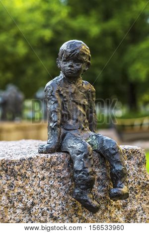 OULU FINLAND - JULY 06 2016: Detail (boy Marti) of Sanna Koivisto's bronze sculpture Passage of Time depicts people from different centuries who have contributed to the success of the city Oulu.