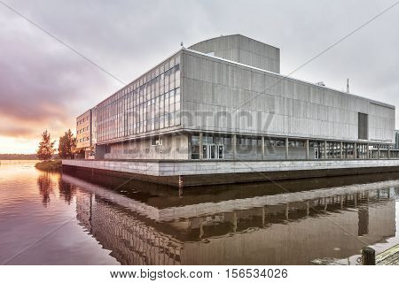 Oulu City Theatre is located on Vanmanninsaari island in Oulu River. Since the theatre is somewhat larger than the island part of it is built out over the water.