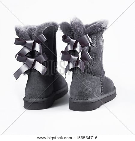 female winter grey shoes over white background
