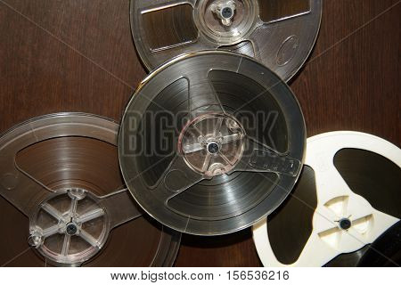 Rare reel to tape recorder. Vintage bobine with the music. Nineteenth - twentieth century - most popular medium of recorded music. Historical analog media sound information for gramophones.