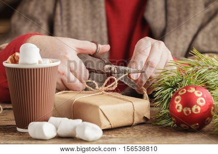 Adult Man Preparing Thread For Tying Xmas Gifts