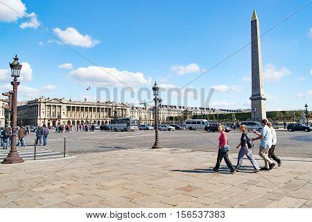PARIS, FRANCE - circa April 2016: Tourists and citizens on the Place de la Concorde in historical part of city