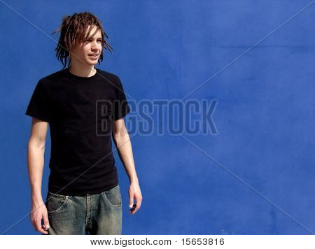 Punk Rocker against blue wall
