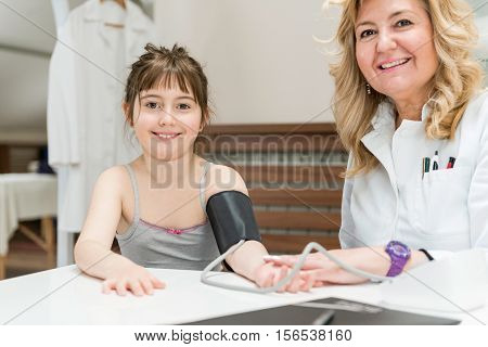 Pediatrician With Little Girl
