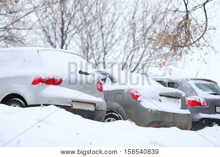 Cars on a parking after a snowstorm in Moscow, Russia