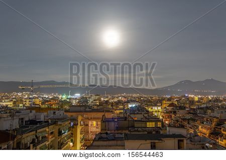Super Moon rises over Thessaloniki, Greece. The Super Moon rises on the northern side of the city by Mount Chortiatis.
