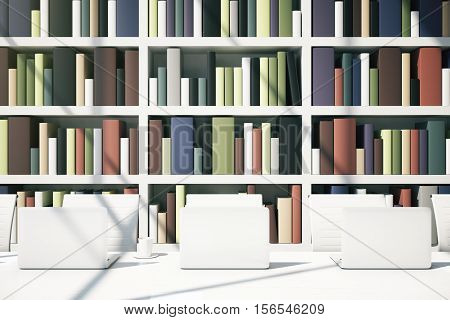 Close up of white table with computer monitors on bookcase background. Library concept. 3D Rendering
