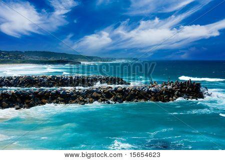 Waves crash on Rocks
