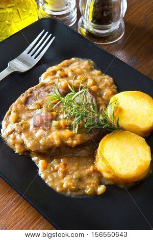 dish with some braised meat with polenta