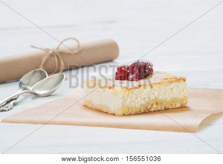 Cheesecake On Baking Paper On Table