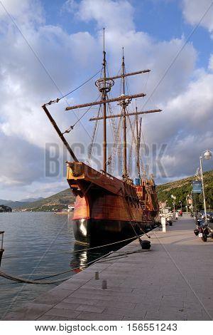 DUBROVNIK, CROATIA - NOVEMBER 30: Motor sailboat Karaka (2004) in port of Dubrovnik, Croatia. Replica of 16th c. sailing vessel Karaka type, provides cruises around Dubrovnik on November 30, 2015.