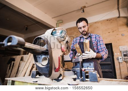 Framing contractor using a circular cut off saw to trim wood studs to length
