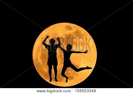 Abstract couples leap position silhouette against the super moon.