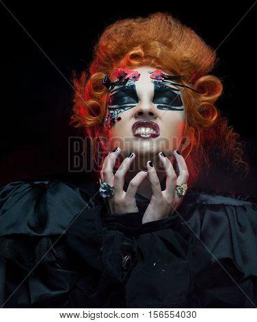 Gothic redhair witch. Dark woman. Halloween picture.