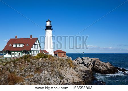 Portland Head Lighthouse is located at the entrance of Portland Harbor in Cape Elizabeth Maine USA.