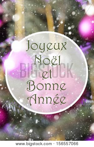 French Text Joyeux Noel Et Bonne Annee Means Merry Christmas And Happy New Year. Vertical Christmas Tree With Rose Quartz Balls. Close Up Or Macro View. Snowflakes For Winter Atmosphere.