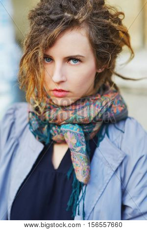 Wonderful portrait of pretty slavonic girl with beautiful blue eyes in the street closeup.