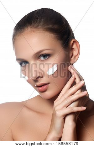 Skin Care Lady Putting Face Cream. Attractive Brunette Girl On W
