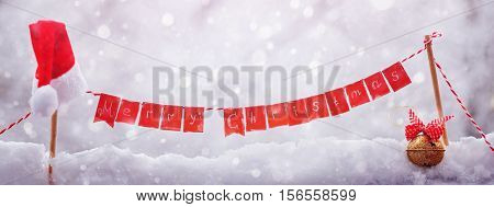 Christmas background with metal jingle bell and hat santa