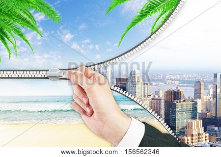 Abstract image of hand zipping city into beach. Holidays concept