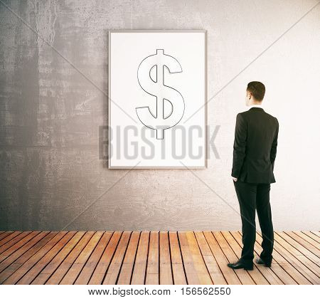 Back view of businessman in interior looking at a picture frame with dollar sign. Financial growth concept. 3D Rendering