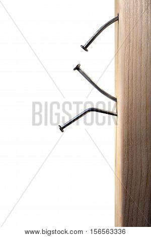 Bent Construction Nails in Wood with White Background
