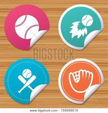 Round stickers or website banners. Baseball sport icons. Ball with glove and two crosswise bats signs. Fireball symbol. Circle badges with bended corner. Vector