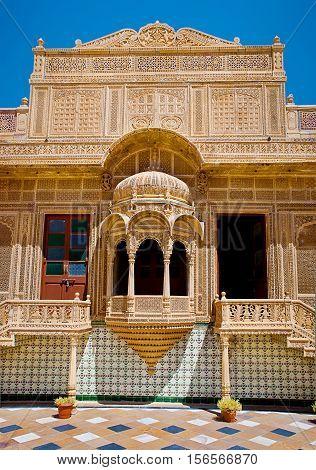 JAISALMER INDIA - September 22: Carved window in Mandir Palace September 22 2013 in Jaisalmer India.