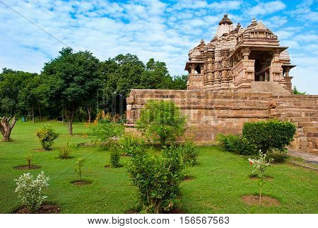 Kandariya Mahadeva Temple dedicated to Shiva Western Temples of Khajuraho under cloudy sky. Khajuraho is UNESCO World heritage site and is popular tourist destination. India.
