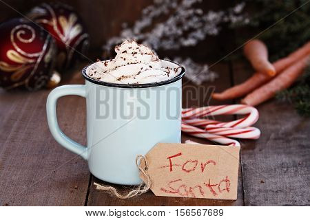 Cup of hot cocoa with whipped cream and chocolate shavings. Note that reads