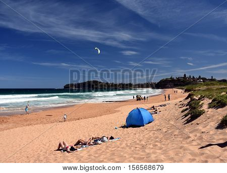 Sydney Australia - Nov 6 2016. People relaxing at the beach on the first hot day in the season. Mona Vale Sydney NSW Australia.