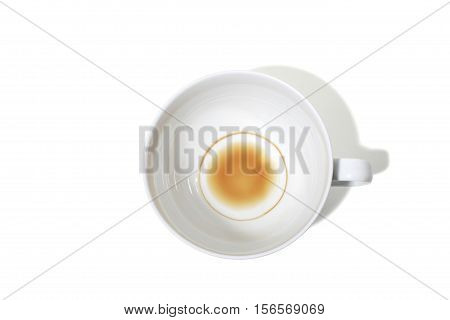 Still Life of a Coffee Stain in the Bottom of a Empty Coffee Cup on White Background