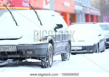 Moscow, Russia - November, 12, 2016: Cars on a parking after a snowstorm in Moscow, Russia