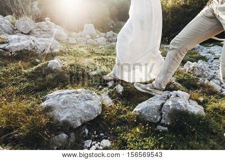 a couple walking in sunrise