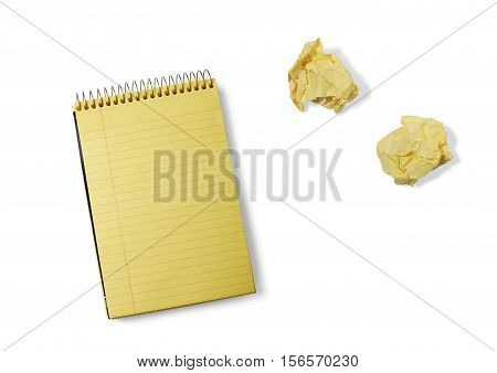 Still Life of a Pad of Yellow Notepad and Crumpled Paper Wads on White Background