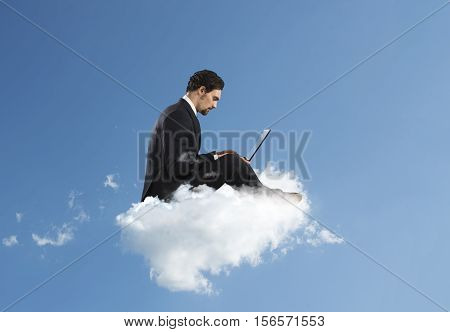 Businessman with laptop on a cloud in the sky. Internet and social network concept