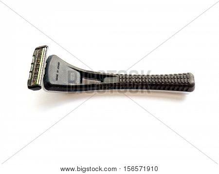 GOMEL, BELARUS - AUGUST 3, 2016: Used FEATHER Safety blade MR 3 Neo on a white background. FEATHER Safety Razor Co., Ltd  was istablished July 1 1932 in Osaka, Japan.