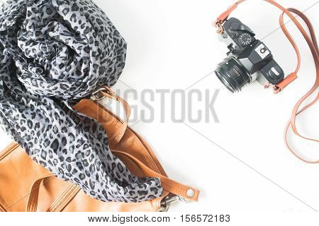 Fashion woman's accessories with film camera vintage concept top view flat lay isolated on white background