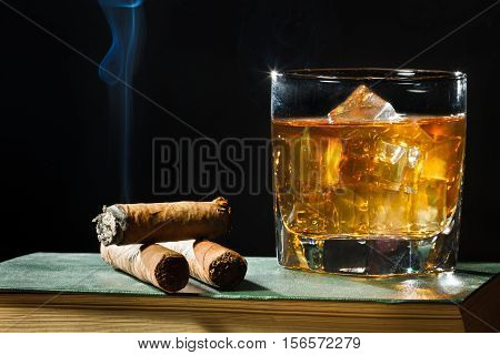 Tree Cigar And Whisky With Ice In Glass
