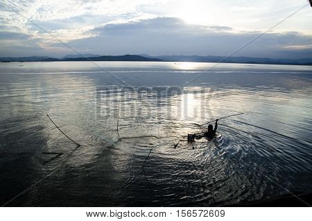 The Fisher man against the fish on the river