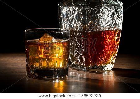 Carafer And Glass With Ice With Whisky