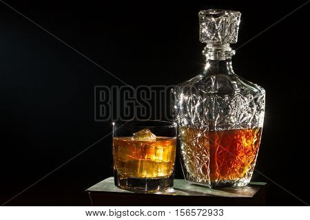 Whisky With Glass And  Carafer On Book